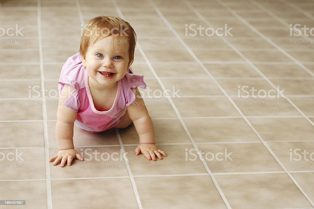 Happy Redhead on Tile Floor stock photo
