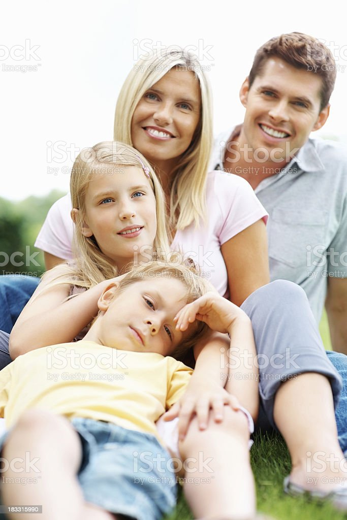 Happy relaxed family sitting together outdoors royalty-free stock photo