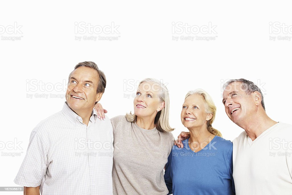 Happy retired couples looking away at copyspace royalty-free stock photo