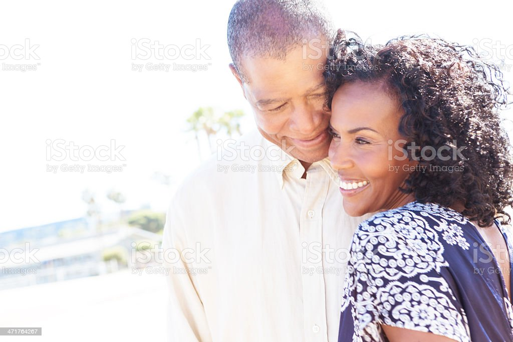 Happy retirement age couple walking while on date stock photo