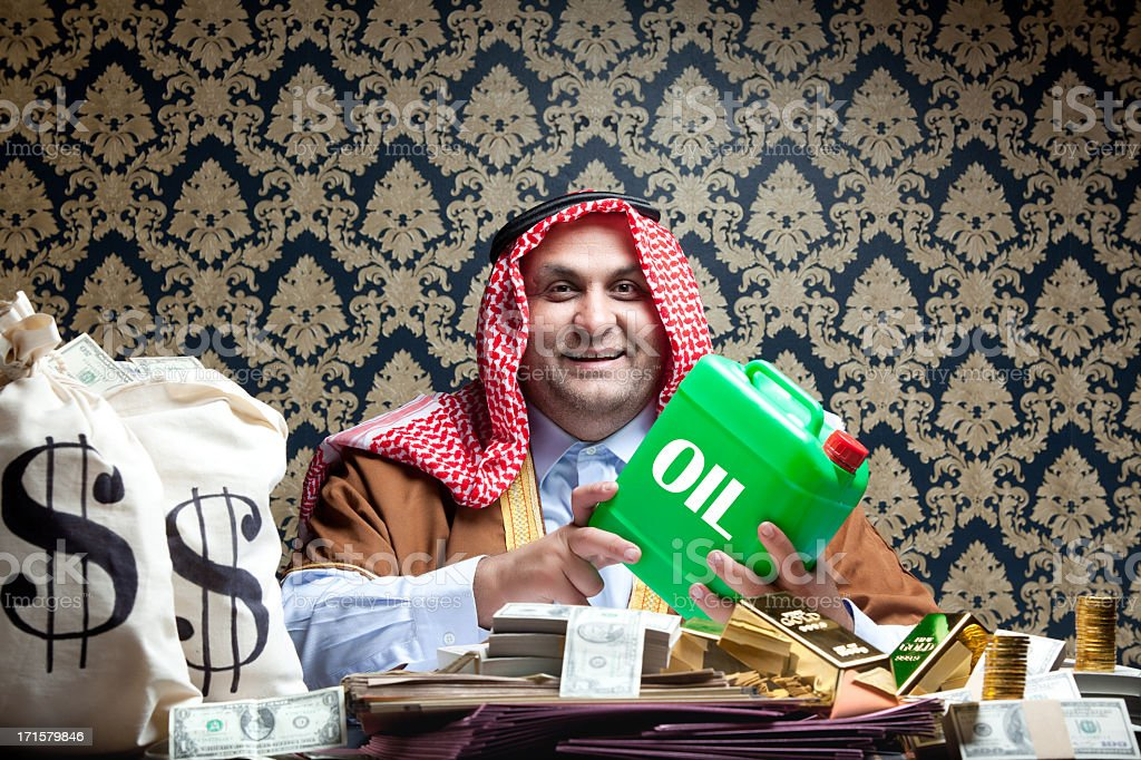 Happy rich arab sheik and his dollars, gold, oil royalty-free stock photo