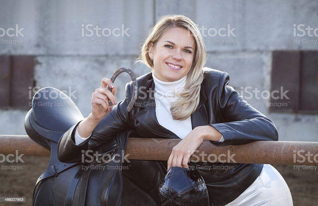 Happy rider with a horseshoe royalty-free stock photo