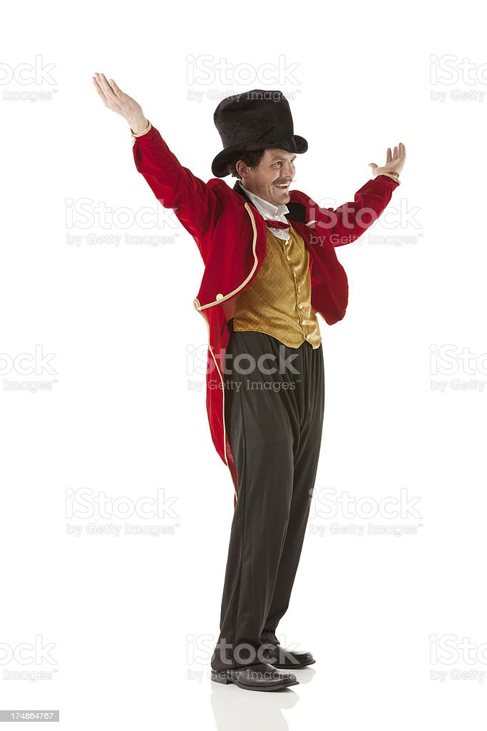 Happy ringmaster with hands raised stock photo