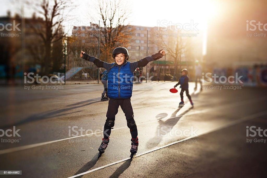happy roller skating boy stock photo