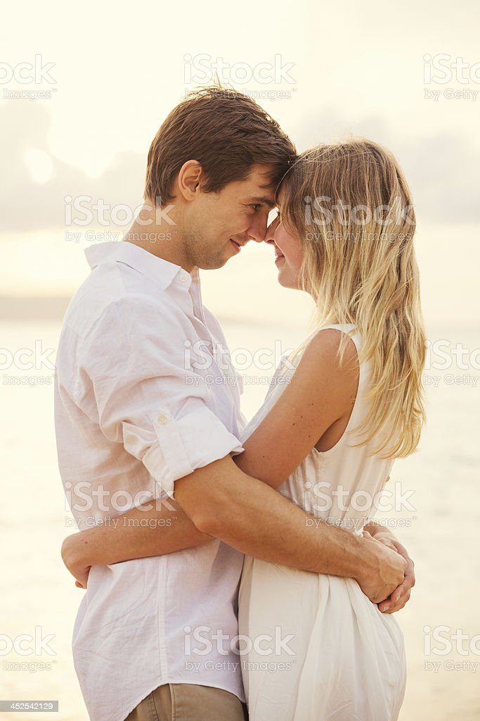 Happy romantic couple having loving moment touching foreheads lo royalty-free stock photo