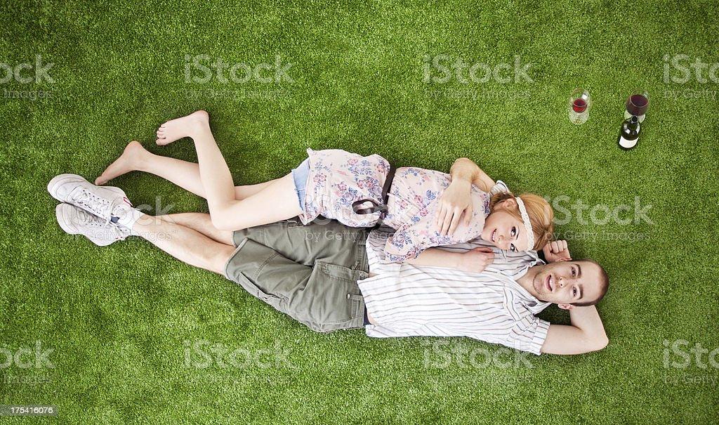 Happy Romantic Couple On Grass stock photo