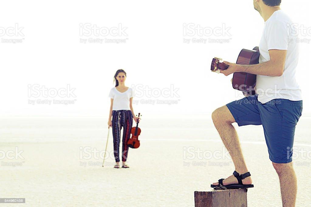 happy romantic young couple on salt lake. stock photo