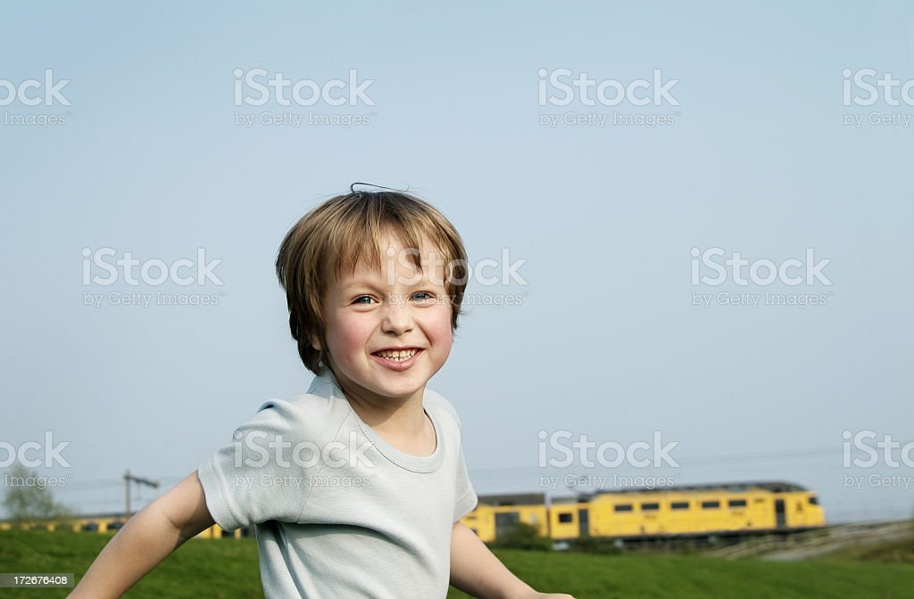 Happy running boy stock photo