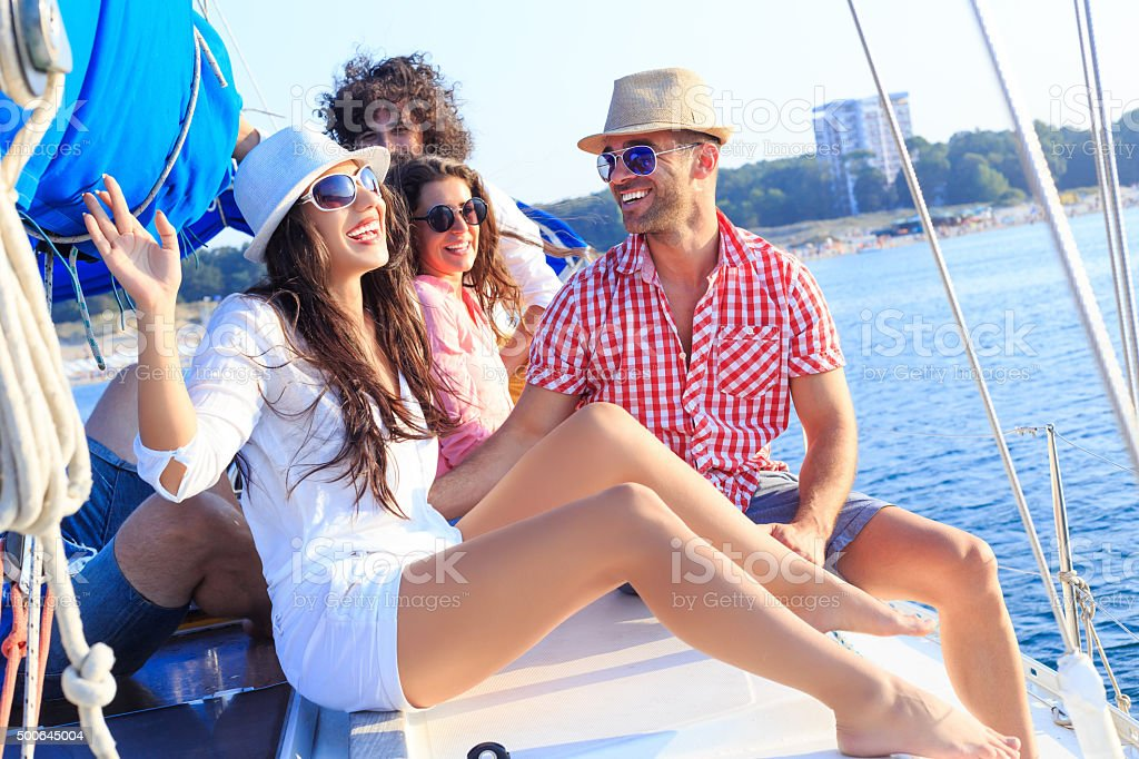 Happy sailing crew on boat stock photo