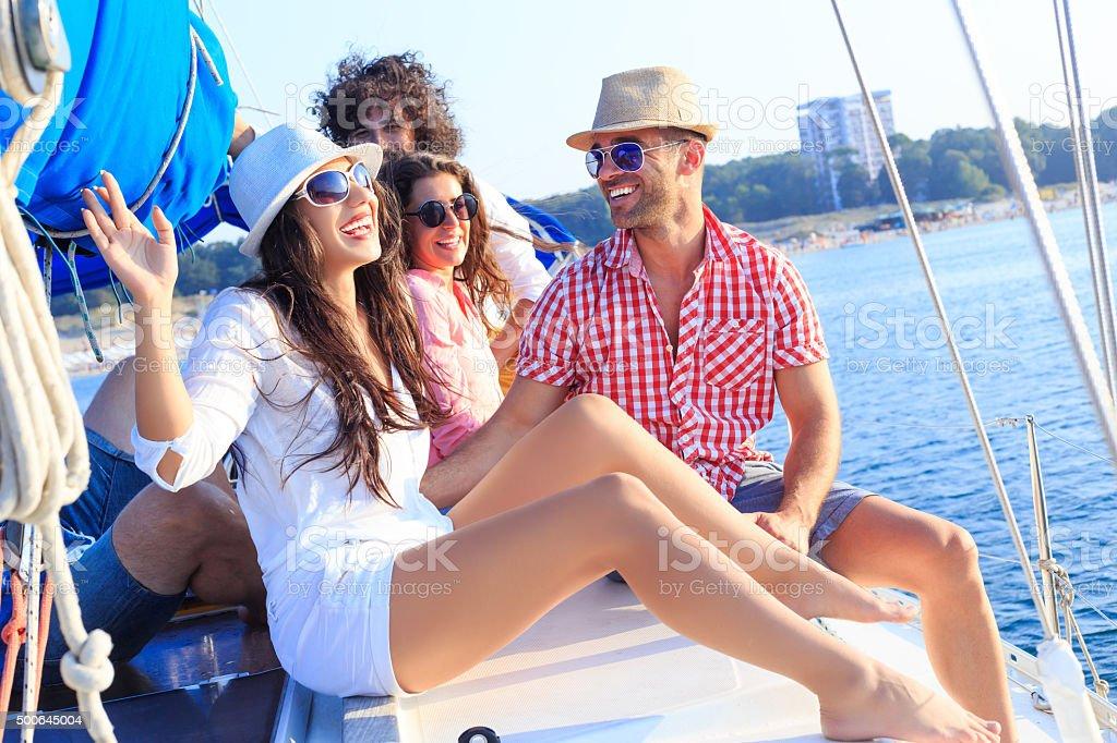 Happy sailing crew on boat stock photo
