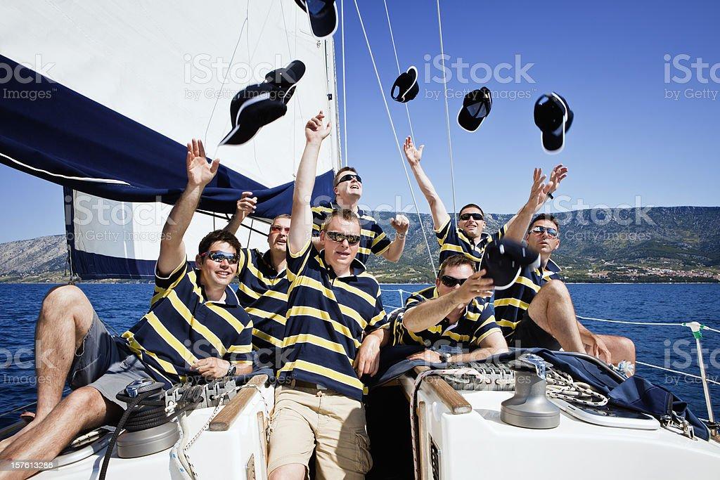 Happy sailing crew on sailboat stock photo