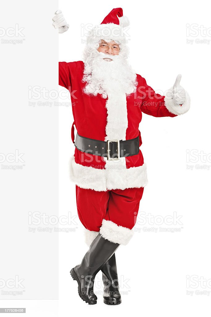 Happy Santa claus next to a billboard royalty-free stock photo