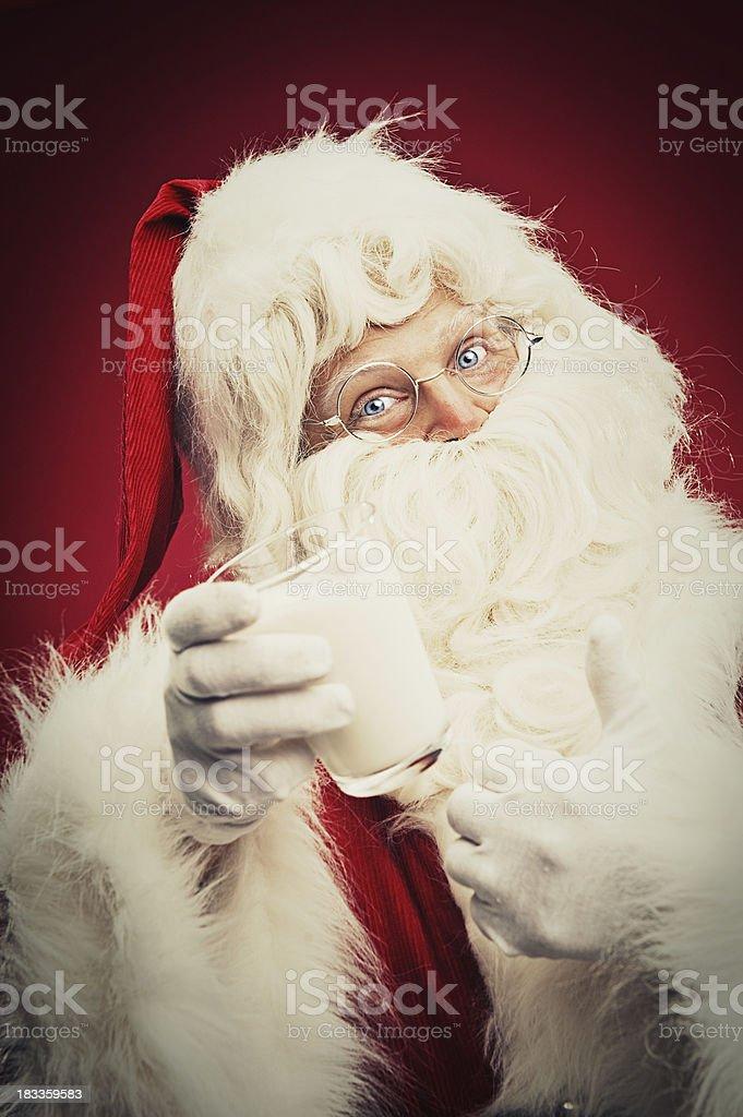 Happy Santa Claus with milk stock photo