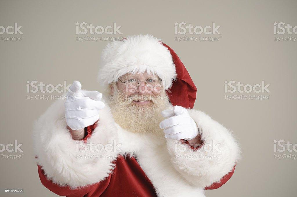 happy santa pointing at the viewer royalty-free stock photo