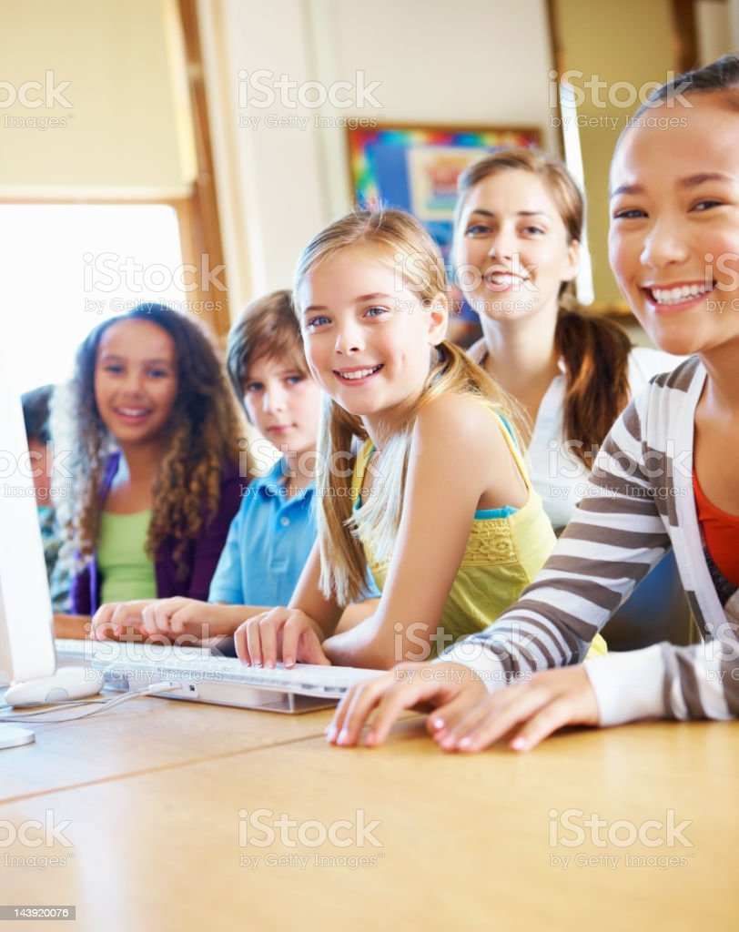 Happy school children in computer lab royalty-free stock photo