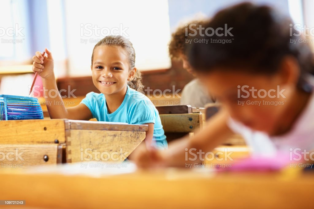 Happy school girl in the classroom royalty-free stock photo