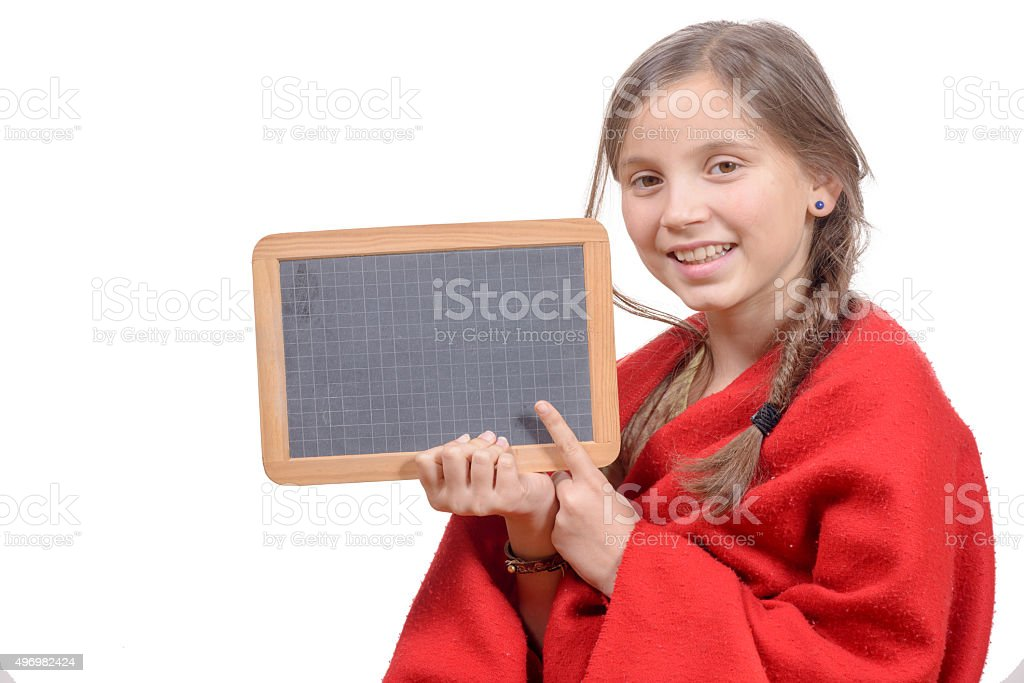 happy school girl with a traditionnal slate in his hands stock photo