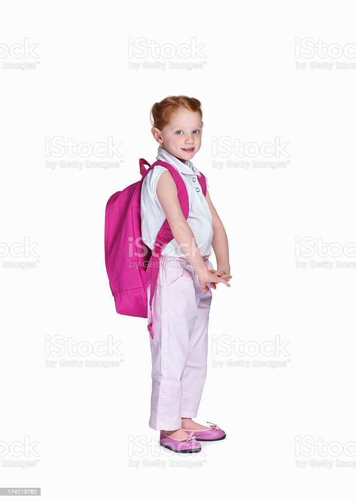 Happy school girl with backpack isolated on white background stock photo