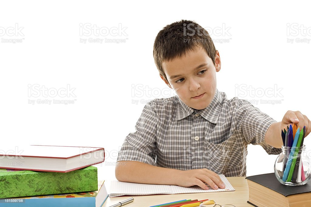 Happy schoolboy take a pencil royalty-free stock photo