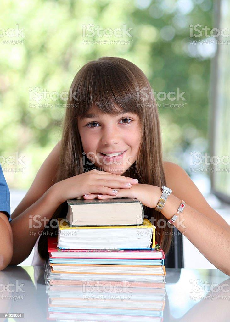 Happy schoolgirl with many books. royalty-free stock photo