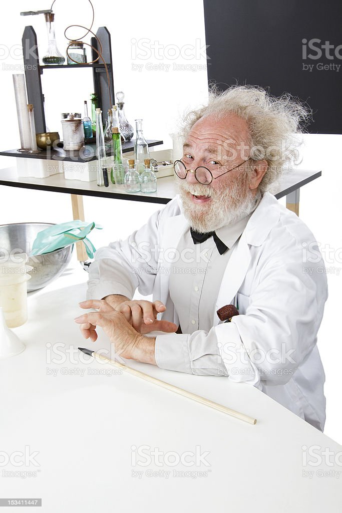 Happy scientist in lab with pointer ready to explain ideas royalty-free stock photo