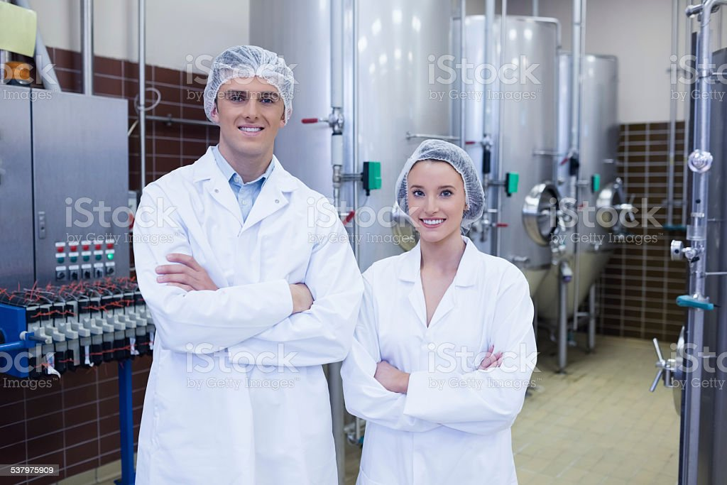 Happy scientists posing with arms crossed stock photo