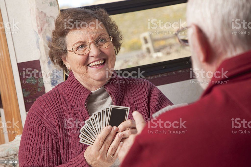 Happy Senior Adult Couple Playing Cards royalty-free stock photo
