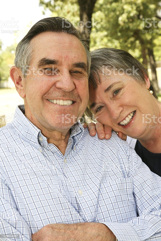 Happy Senior Adult Couple Together in the Front Yard royalty-free stock photo