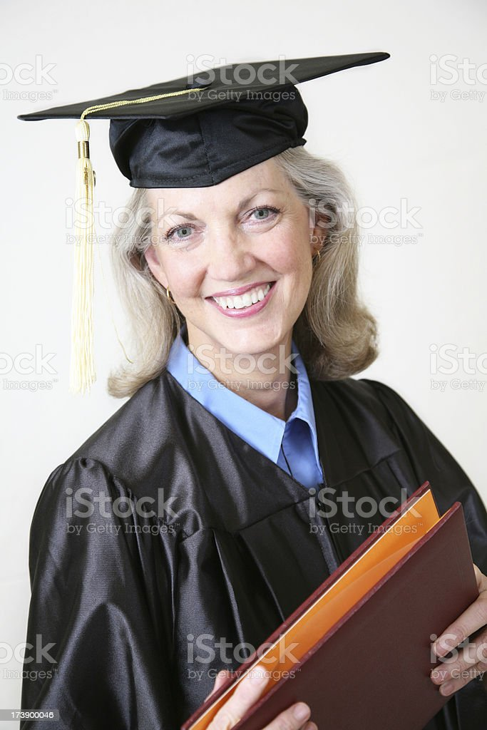 Happy Senior Adult Graduate with her Diploma royalty-free stock photo