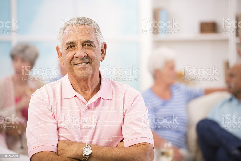 Happy, senior adult man at home or community center. Friends. stock photo
