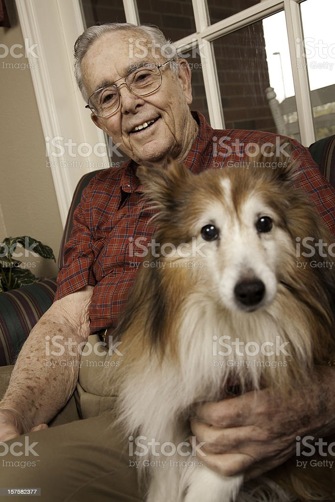 Happy Senior Adult with His Dog royalty-free stock photo