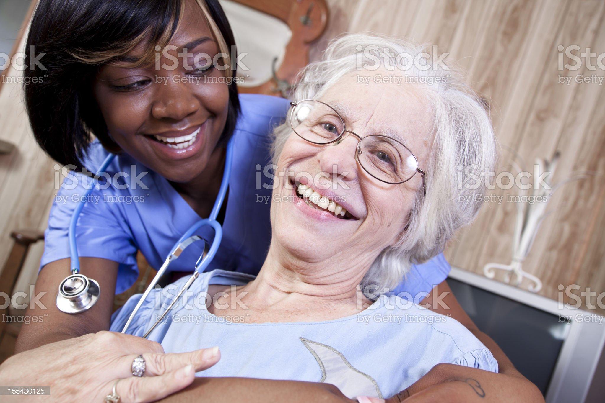 Happy senior adult woman, hug from home healthcare nurse. Nursing. royalty-free stock photo