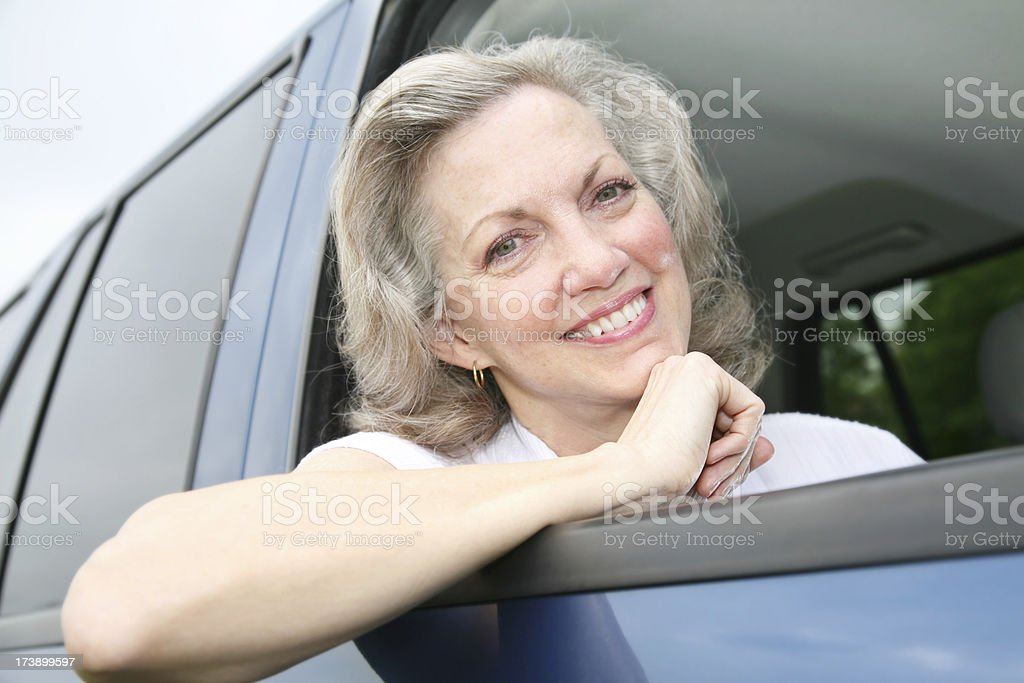 Happy Senior Adult Woman with Elbow out of Car Window royalty-free stock photo