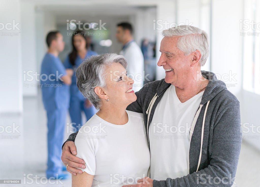 Happy senior adults at the hospital stock photo