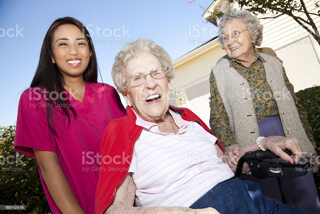 Happy Senior Adults With Their Caretaker royalty-free stock photo