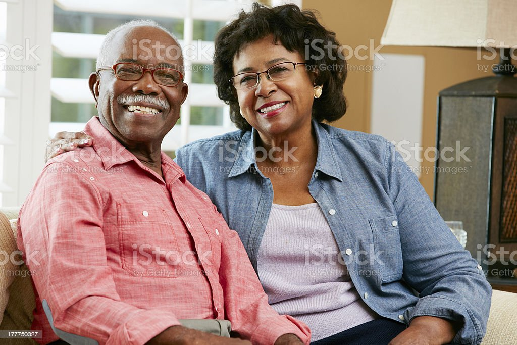 Happy senior African American couple at home stock photo