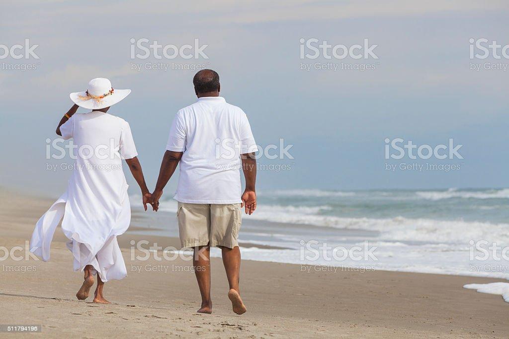 Happy Senior African American Couple Man Woman on Beach stock photo