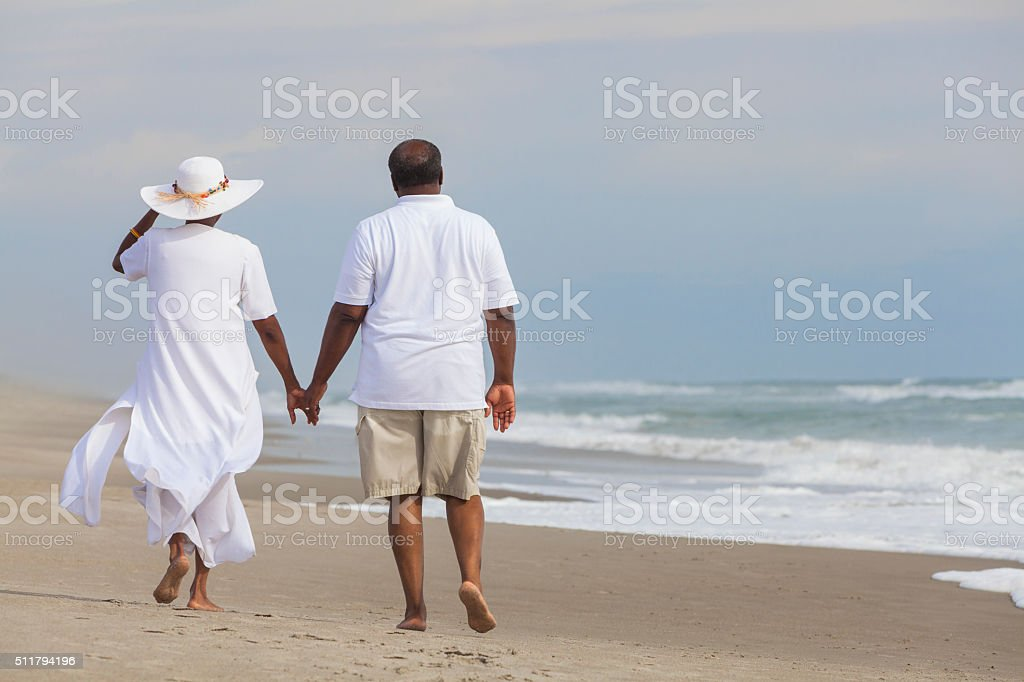 Happy Senior African American Couple Man Woman on Beach stock photo