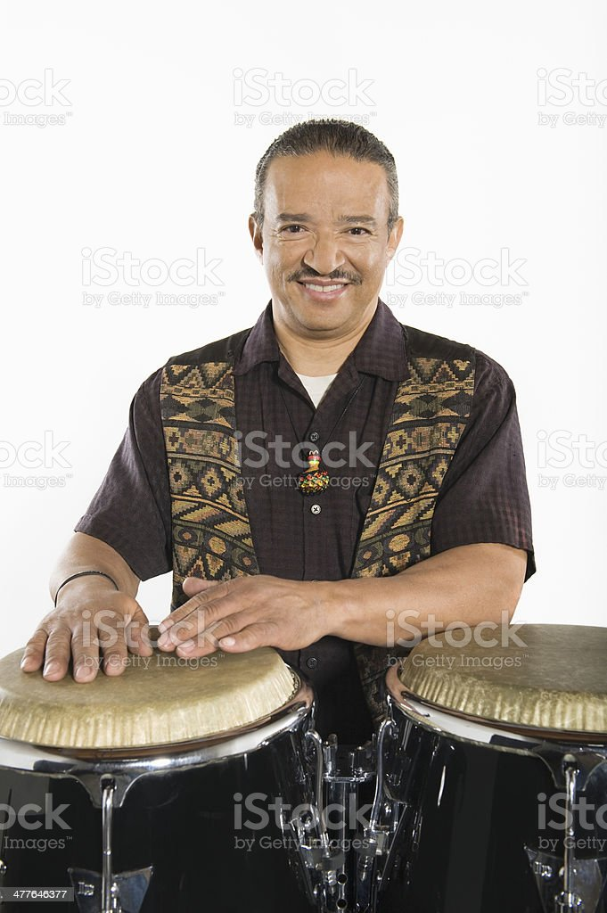 Happy Senior Artist Playing Drums stock photo