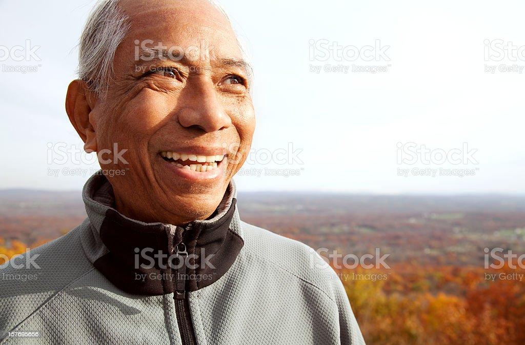 Happy Senior Asian Man in Autumn royalty-free stock photo