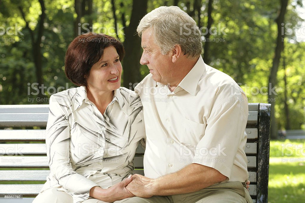 Happy senior attractive couple embracing at park royalty-free stock photo