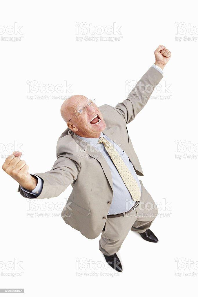 Happy senior businessman raising hands in joy on white background royalty-free stock photo