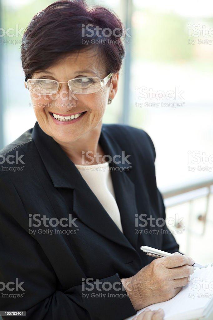 Happy senior businesswoman royalty-free stock photo