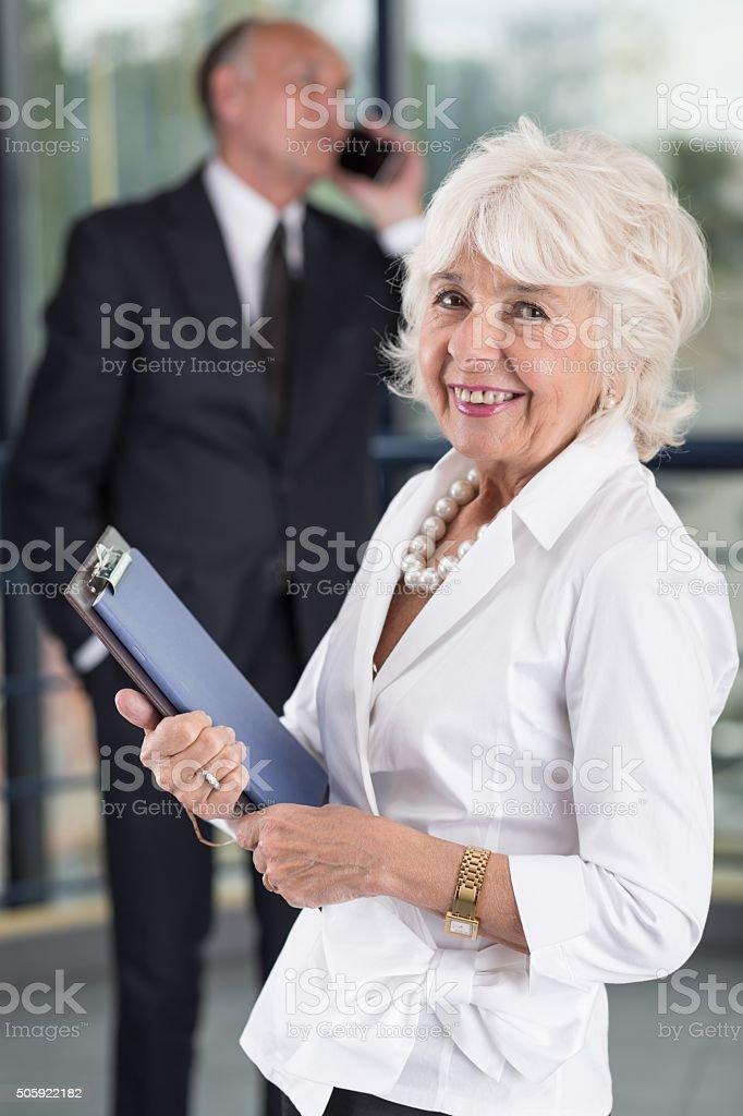 Happy senior businesswoman stock photo