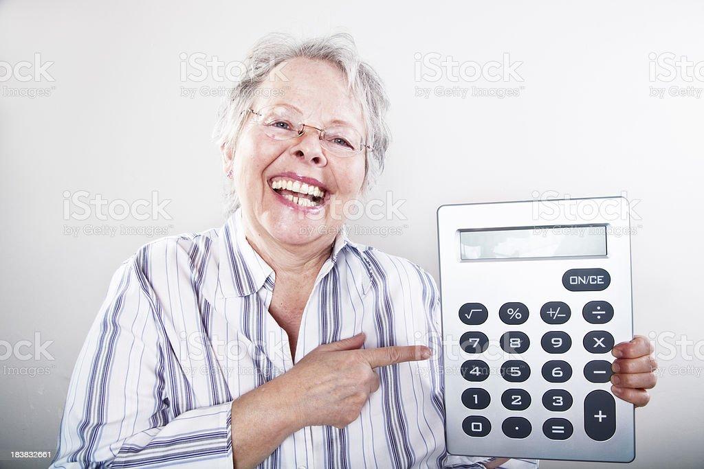 happy senior businesswoman with calculator royalty-free stock photo