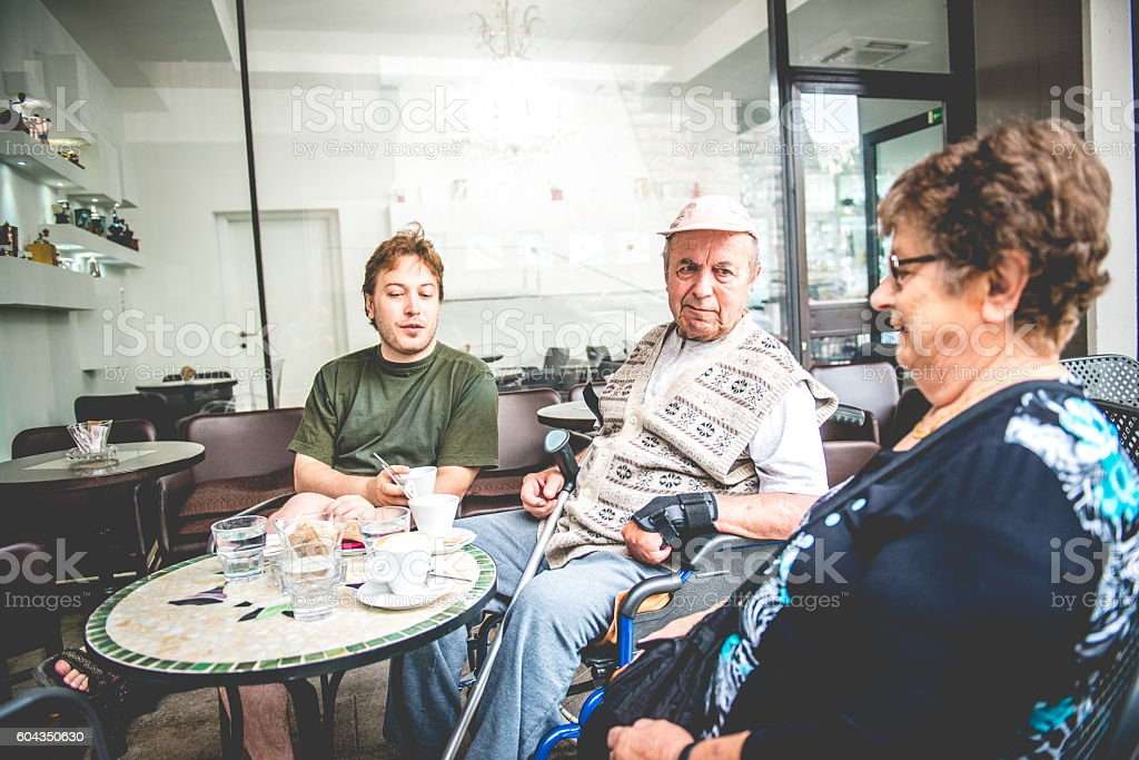 Happy Senior Couple and Grandson Having Coffee, Slovenia, Europe stock photo