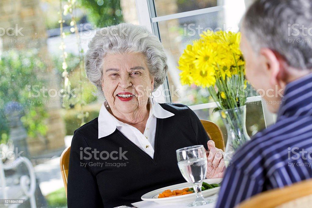 Happy Senior Couple at a Restaurant royalty-free stock photo