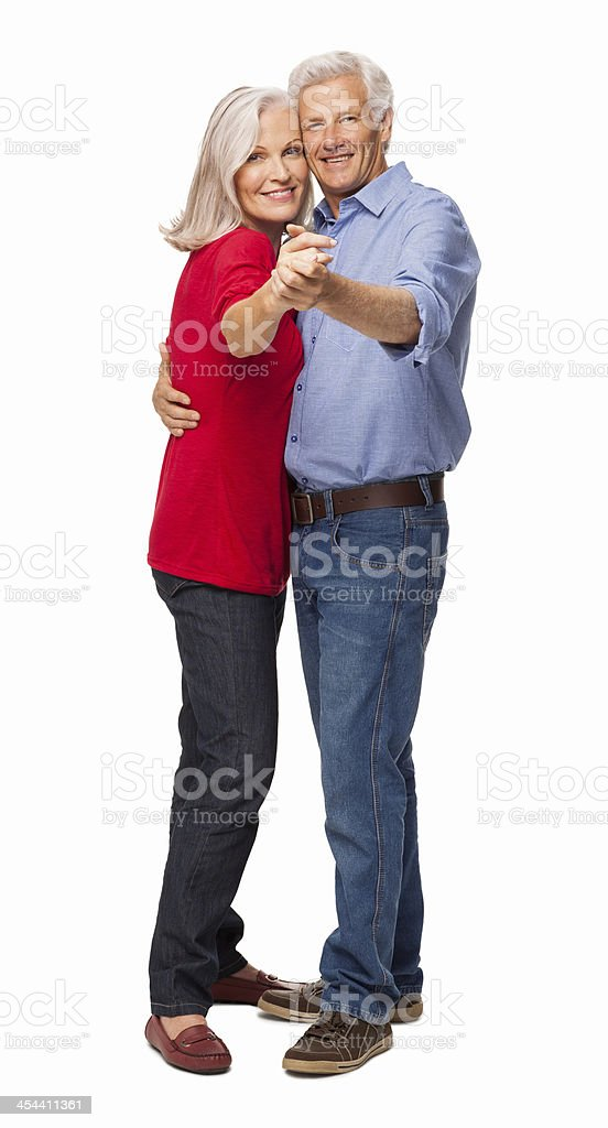 Happy Senior Couple Dancing - Isolated royalty-free stock photo