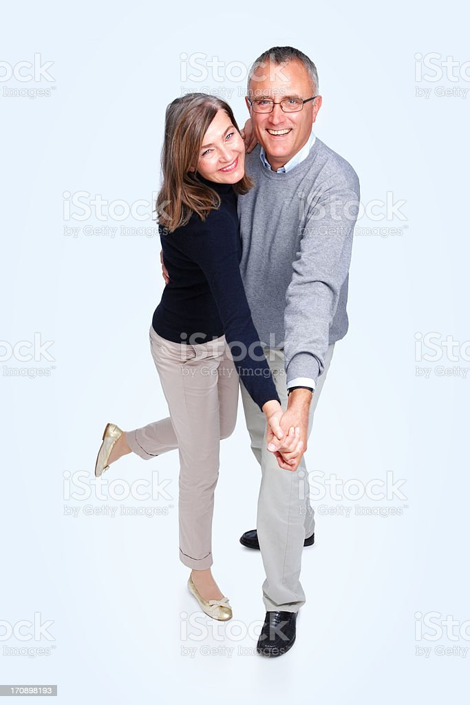 Happy senior couple dancing together on white stock photo