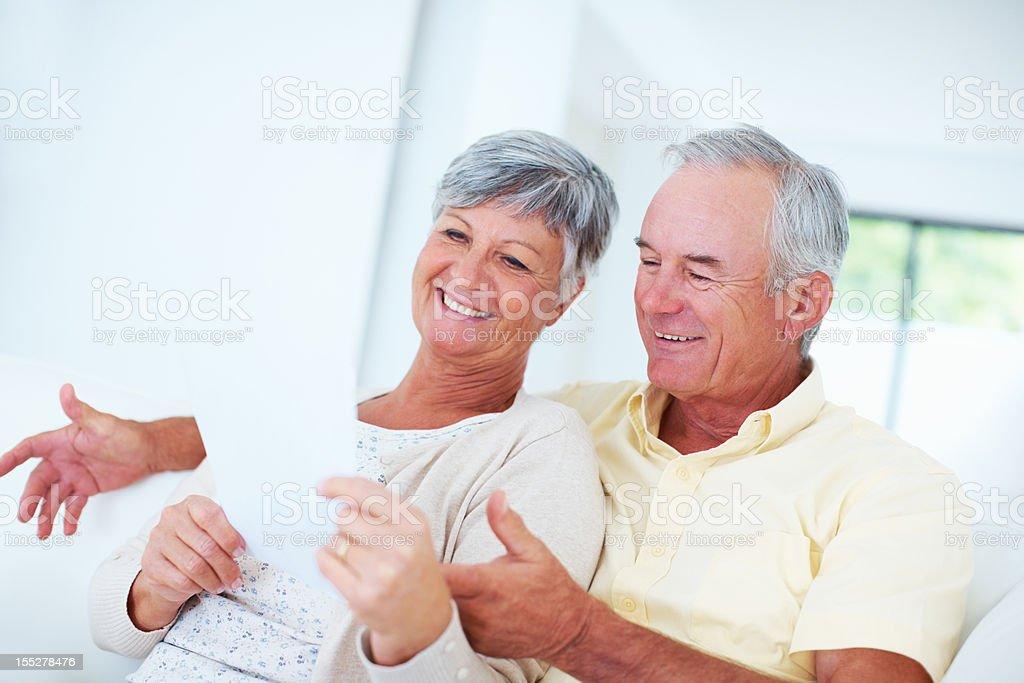 Happy senior couple discussing bills royalty-free stock photo